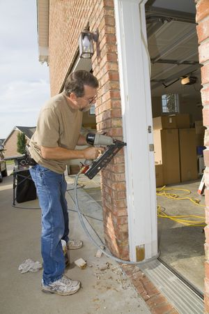door casing: Carpenter repairing exterior door casing, weather & insects have contributed to rot at the bottom of casing