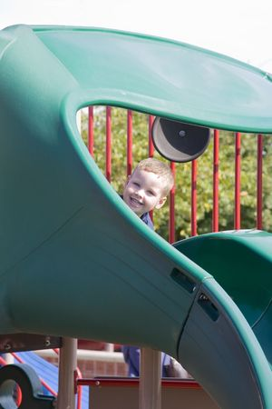 Young child playing at the park play ground on a beautiful summer day Stock Photo - 3629290
