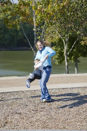 thrilling: Young mother and little boy playing in local park, the weather is turning, fall is arriving