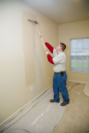 prep: Contract painter updating colors of walls and painting ceilings to make apartment ready to lease Stock Photo
