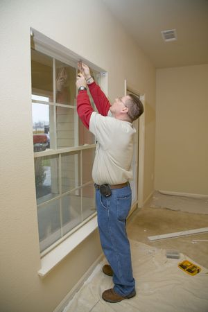 tenant: Repair man replacing window blinds in apartment, Making ready for new tenant  Stock Photo