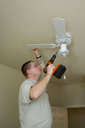 light fixture: Electrician installing new light fixture and fan combination