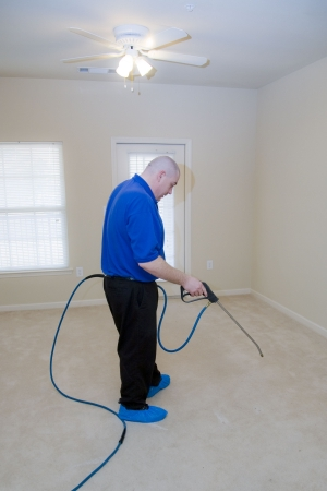 Man cleaning carpet with commercial cleaning equipment Stock Photo - 4388603