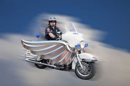 motorcycle officer: Police officer on his motorcycle flying thought the sky with wings