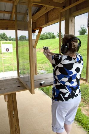 Active woman at the gun range photo