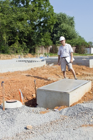 Building inspector checking new plumbing for water coming into new residential communityl Stock Photo - 10060088