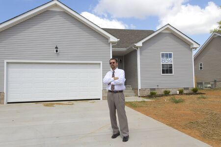 financial controller: Bank finance personal inspecting new home, his company financed the builder
