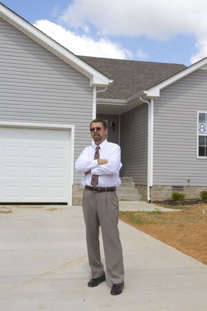financed: Bank finance personal inspecting new home, his company financed the builder in buiding 25 new houses Stock Photo