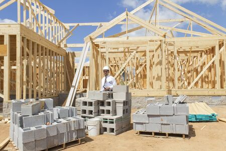 Bank finance personal inspecting new home that is under construction, his company financed the builder Stock Photo - 10361063