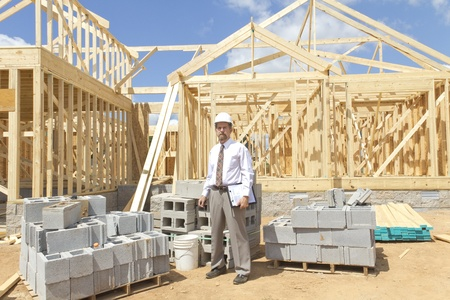 finance director: Bank finance personal inspecting new home
