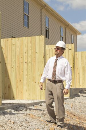 financial controller: Bank finance personal inspecting new strip mall that his company financed