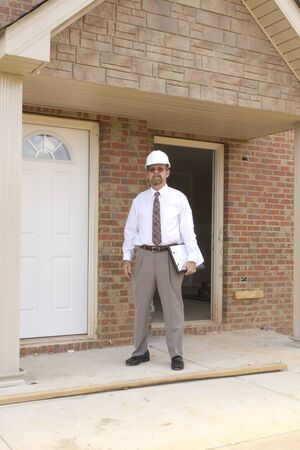 Bank finance personal inspecting new strip mall that his company financed Stock Photo - 10360988