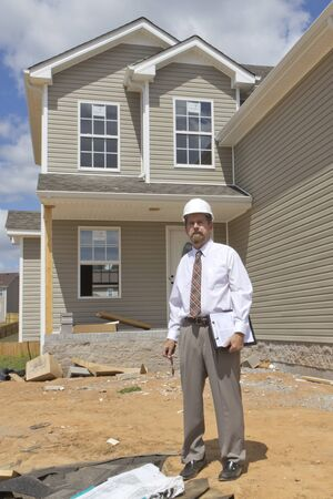 inspection: Bank finance personal inspecting new home, his company financed the builder