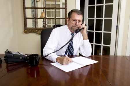 Loan officer at local bank is going to interview business man to better understand his needs Stock Photo - 10633458