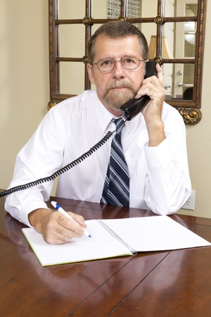 Loan officer at local bank is going to interview over the phone with business man to better understand his needs Stock Photo - 10633457