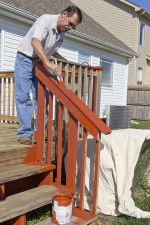 Contract painter staining deck on home Stock Photo - 10941204