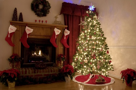 fireplace: Home for Christmas, moms got the house decorated, tree lit up, waiting for santa