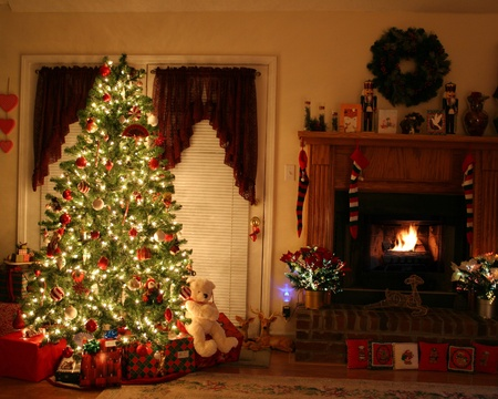 Home with lighted christmas tree, presents,fireplace,stockings
