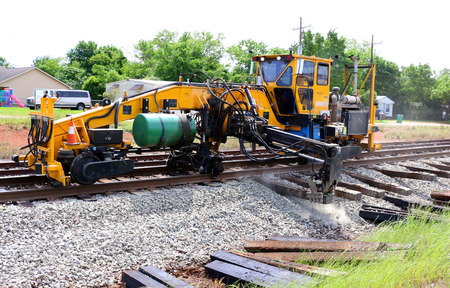 comprising: A method of repairing a damaged railroad rail comprising the steps of: identifying a defect in the rail removing the portion of the rail having a defect and leaving two truncated rail ends preparing the truncated rail ends for welding and welding the two