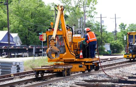 railway track: Railroad workerfulling machine with diesel fuel.