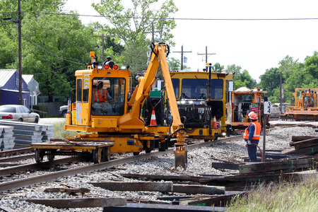 A method of repairing a damaged railroad rail comprising the steps of: identifying a defect in the rail removing the portion of the rail having a defect and leaving two truncated rail ends preparing the truncated rail ends for welding and welding the two