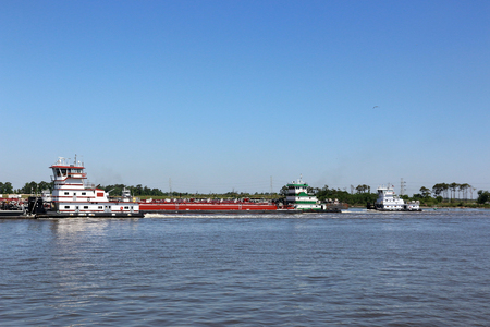 Tug boats moving through the ship channel Stock Photo