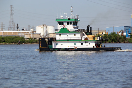 Tug boat going through the Houston ship channel.