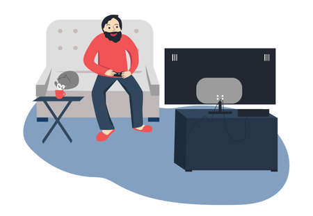 Yong man playing videogame sitting on sofa with cat