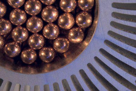 Little golden Metallic Magnetic balls in radiator Stock Photo - 14203291