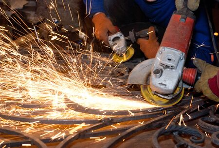 Worker welding metal  Production and construction photo