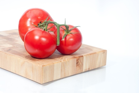 The branch of cherry tomatoes on bred Stock Photo