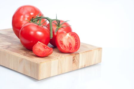 bred: The branch of cherry tomatoes on bred Stock Photo