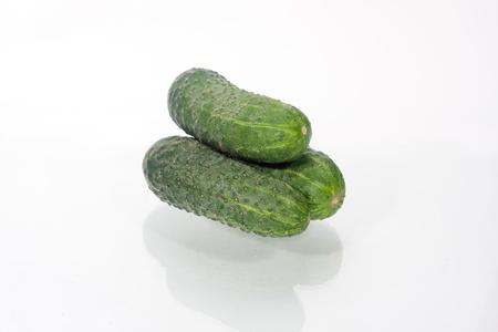 cuke: three green cucumbers isolated on white background