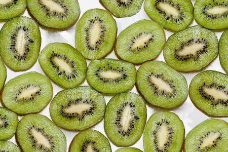 background  made of kiwi slices isolated on white background Stock Photo - 16862822
