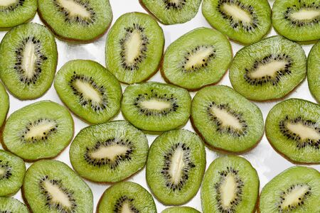 background  made of kiwi slices isolated on white background Stock Photo - 16862822