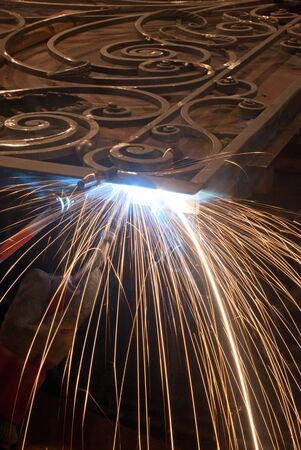 prefabricate: welding metallic object . Production and construction