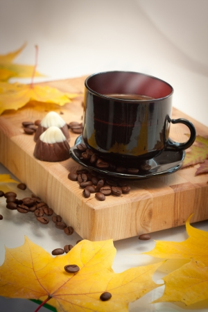 autumn cup of coffee and small chocolate   cookies photo
