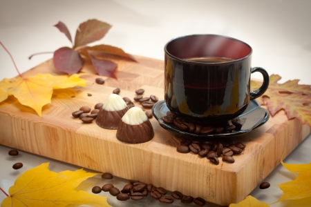 autumn cup of coffee and small chocolate   cookies Stock Photo