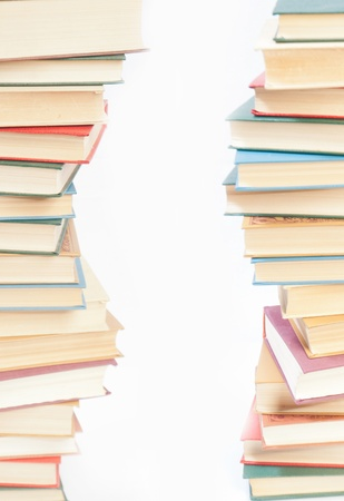 Two towers of books on white background Standard-Bild