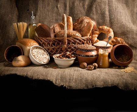 assortment of baked bread on sacking
