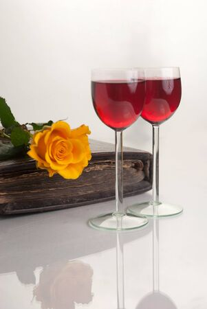 Two Wine Glasses with Red Wine on White Background photo