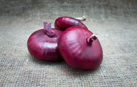 Red onions isolated on white background. Stock Photo