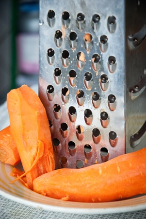 Carrot and grater for vegetables closeup
