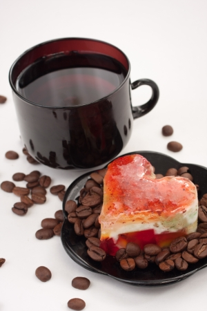 Photo of cute coffee cup with heart-shaped cookies photo