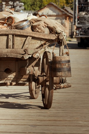 an old cart with barrel, wooden bridge goes on Stock Photo