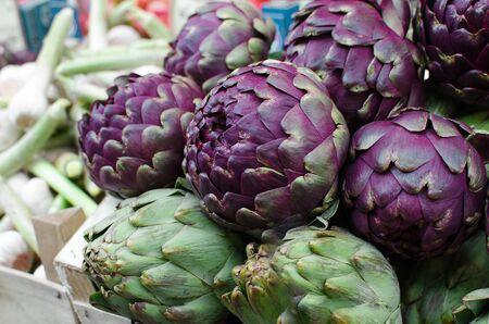 Fresh ripe purple artichokes in the fruit market