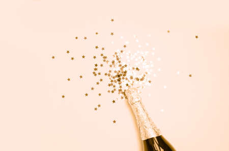 Close-up of champagne explosion on monochrome background