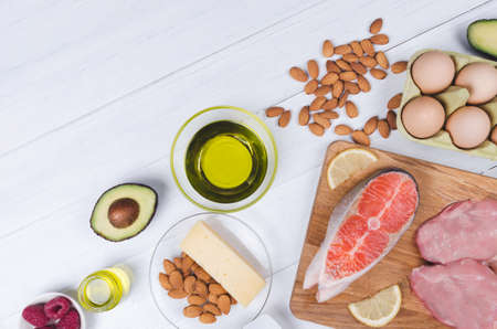 Keto diet, low carb healthy food. avocado, fish, oil, nuts on white background