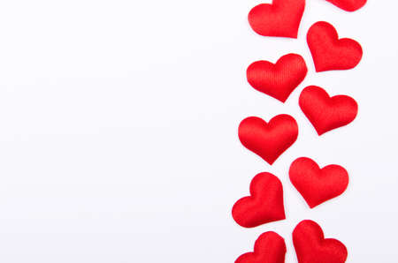 Nice red hearts on white background. Copy space, top view