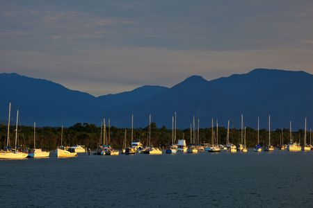 Sailboats in Cairns Harbor at Sunrise photo
